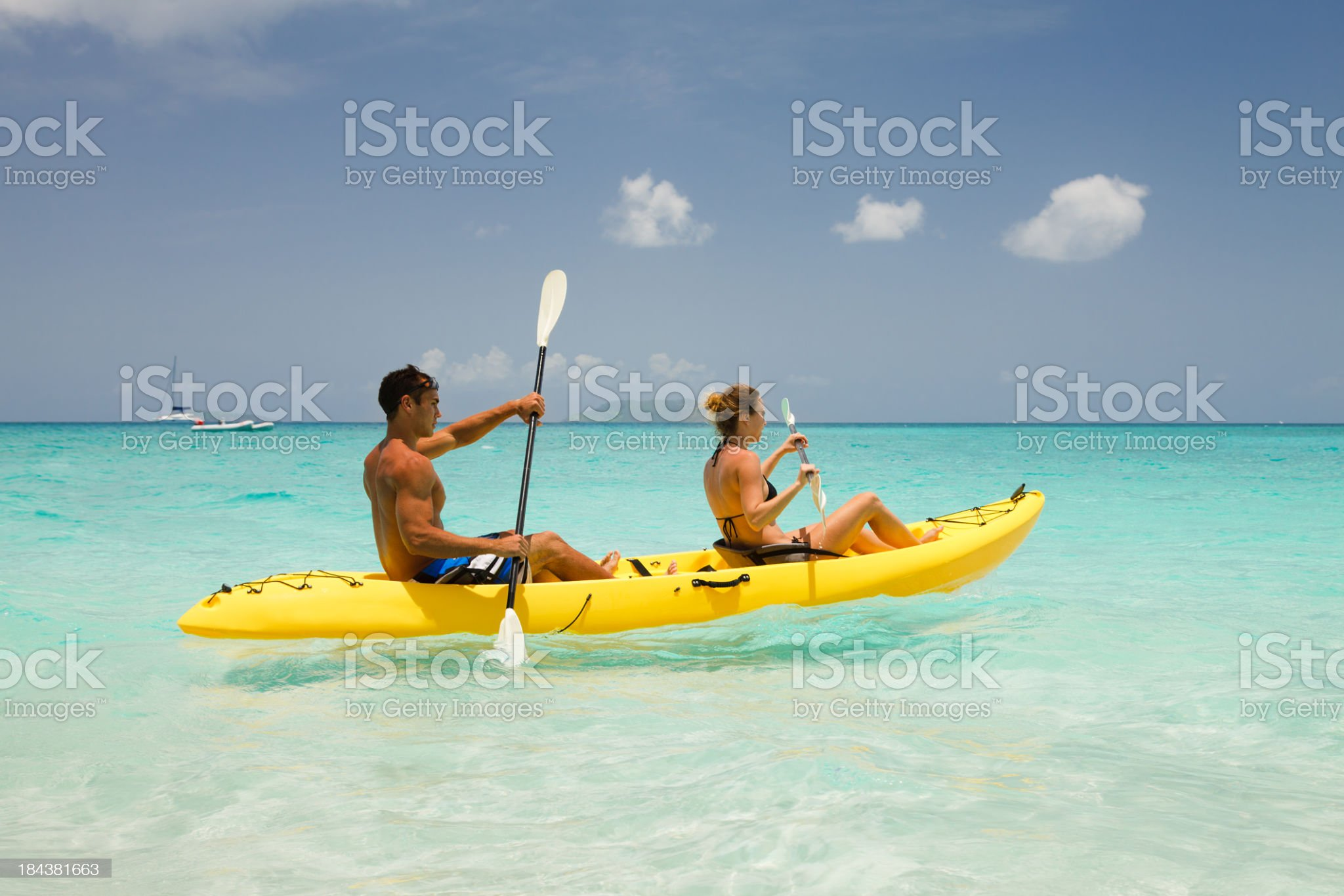 couple kayaking through the Caribbean waters royalty-free stock photo