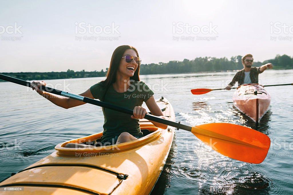 Couple kayaking together. stock photo