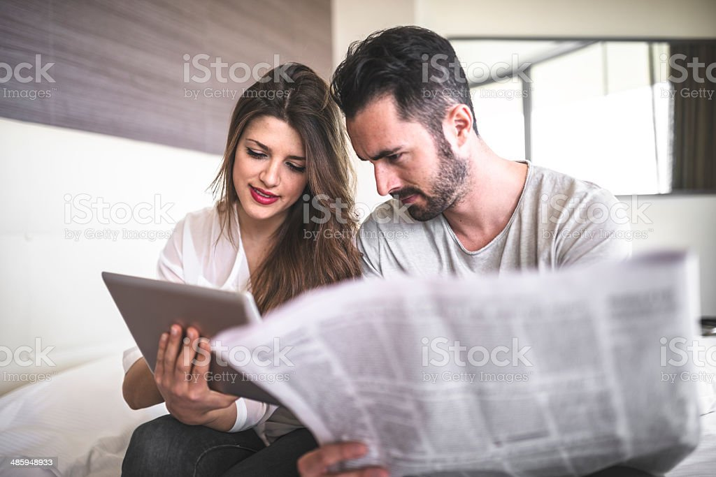 couple keeping update through device stock photo
