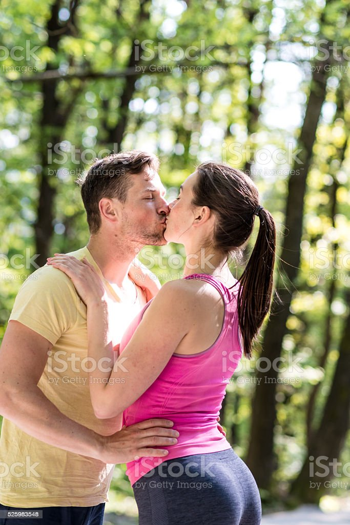 Couple kissing after running stock photo