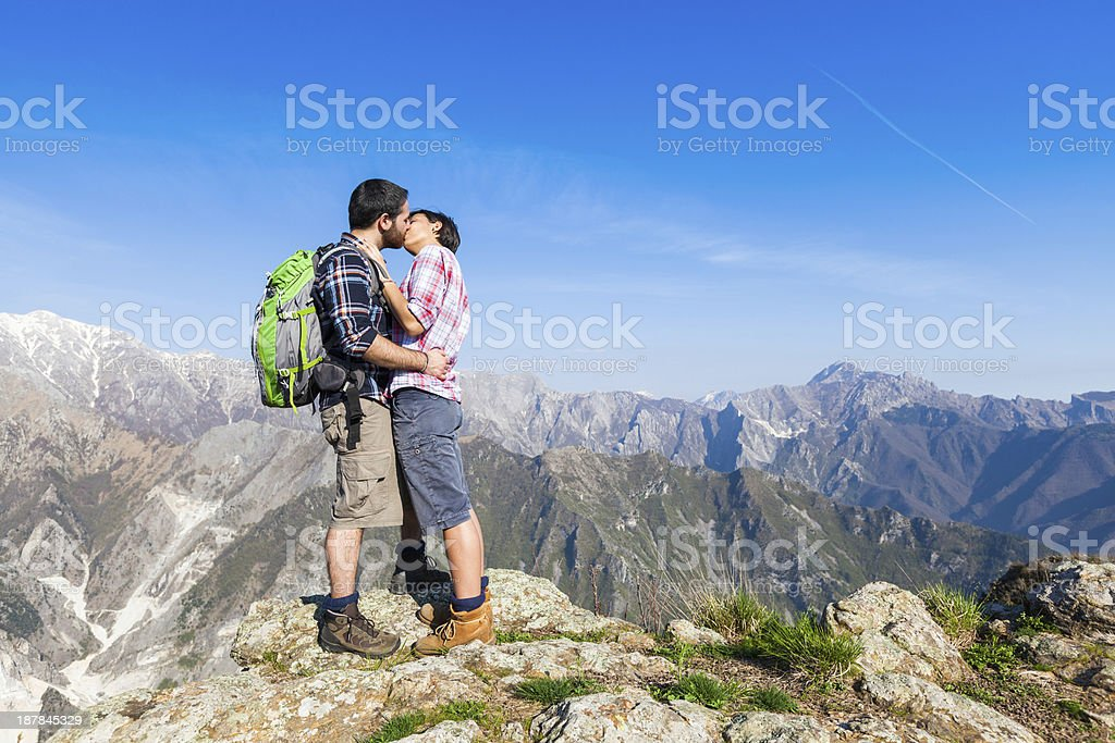Couple Kissing at Top of Mountain royalty-free stock photo