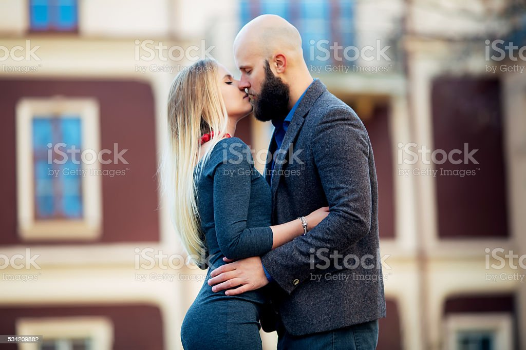 Couple kissing happiness fun. Interracial young couple royalty-free stock photo