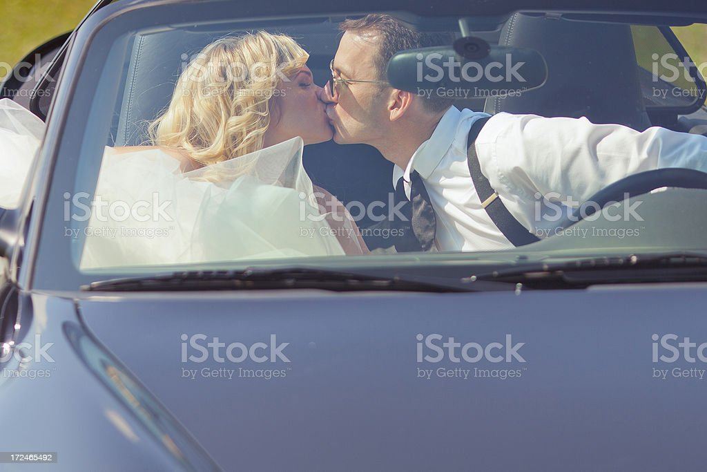 couple kissing in a convertible royalty-free stock photo