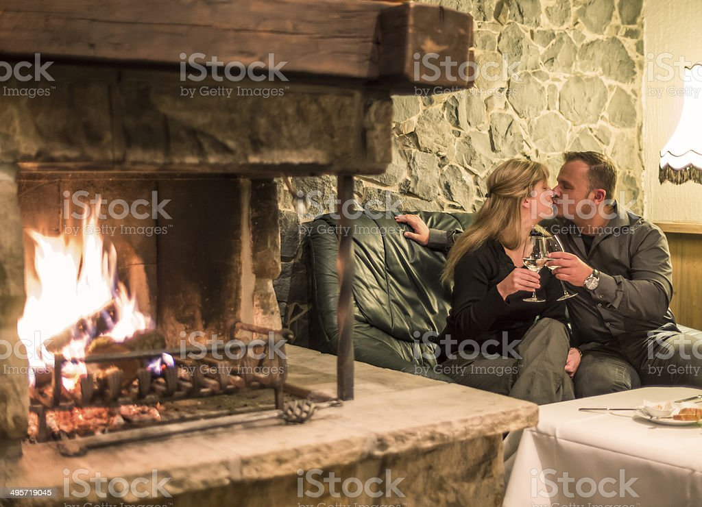Couple kissing in fireplace room royalty-free stock photo