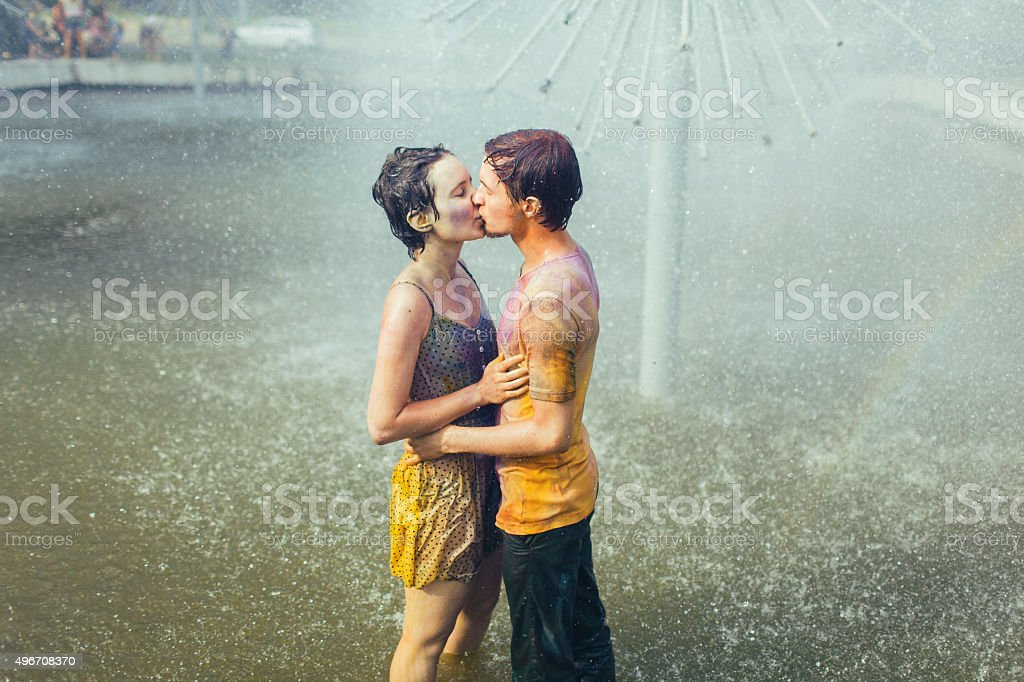 Couple kissing in fountain stock photo