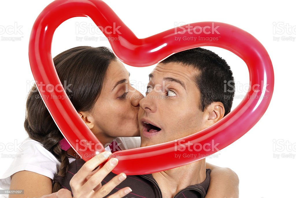 Couple kissing in front of balloon heart royalty-free stock photo