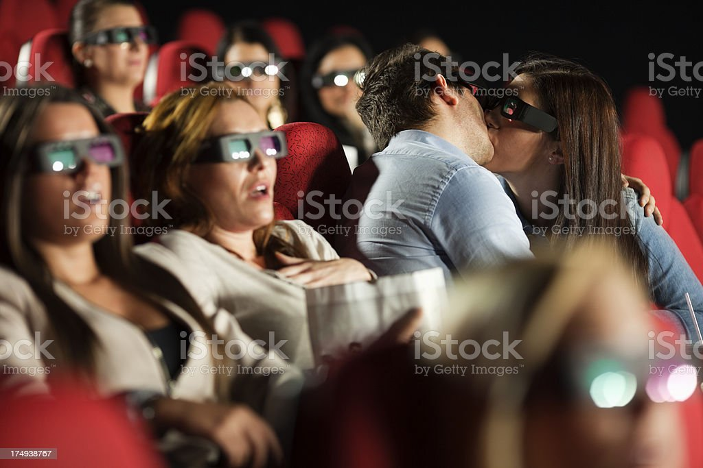 couple kissing in the cinema royalty-free stock photo