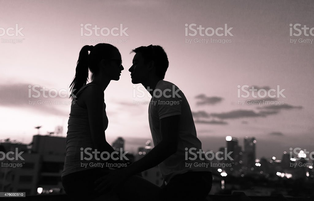 Couple kissing in the city stock photo