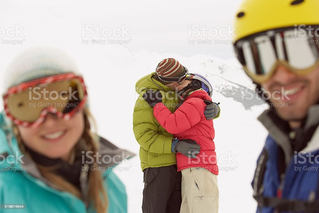 Couple kissing in the snow stock photo