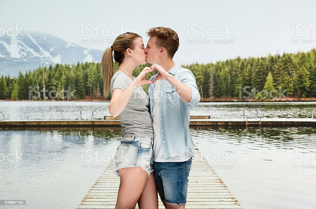Couple kissing in wilderness area stock photo