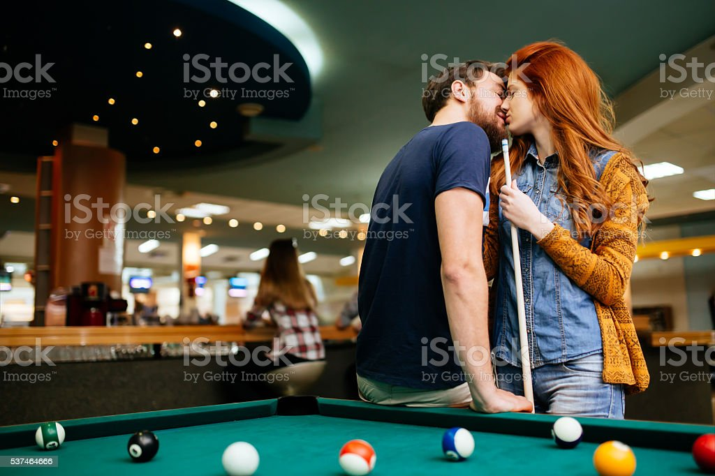 Couple kissing on a date stock photo