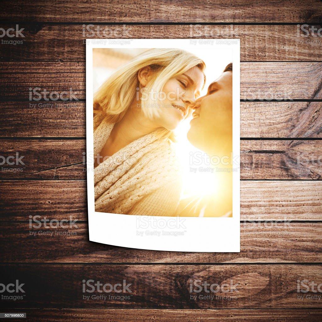 couple kissing on a polaroid stock photo