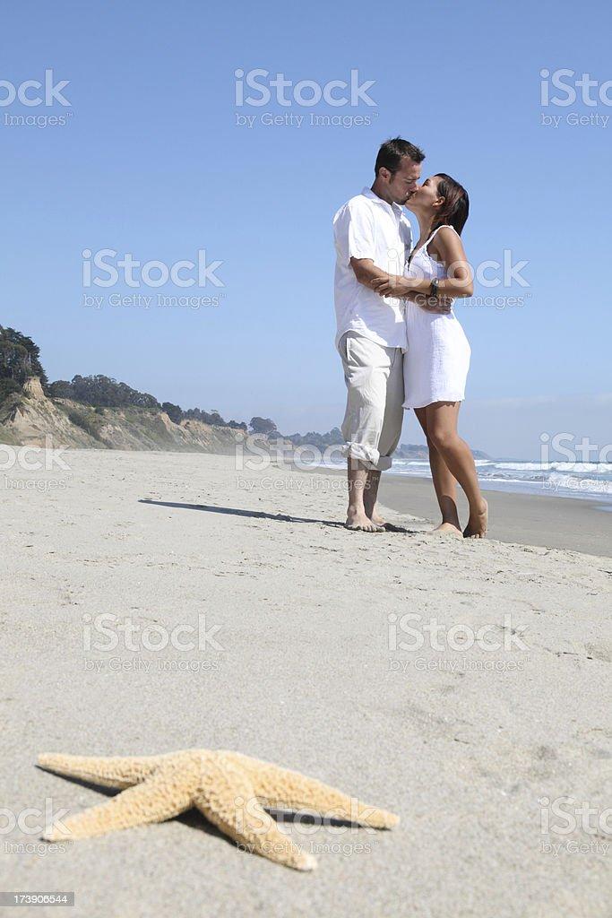 Couple Kissing On Beach royalty-free stock photo