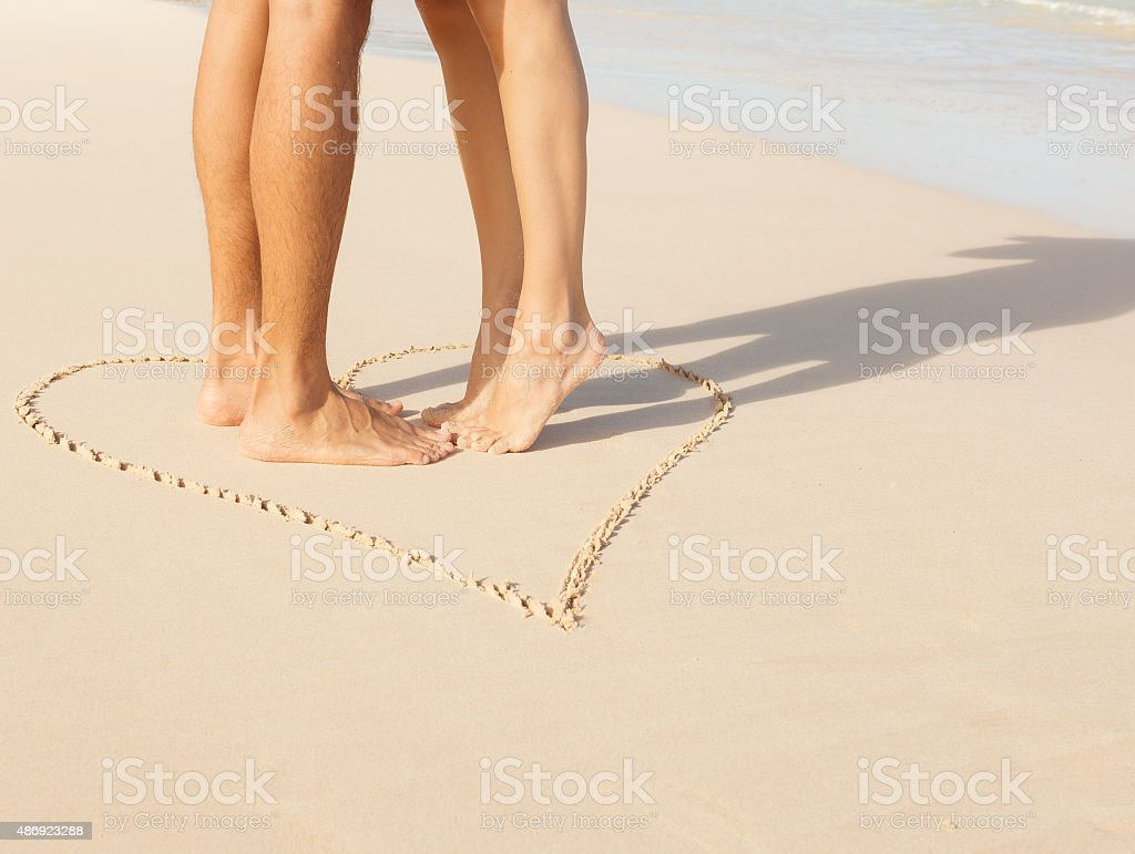 Couple kissing on the beach. stock photo