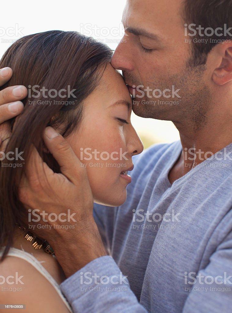 Couple kissing outdoors stock photo