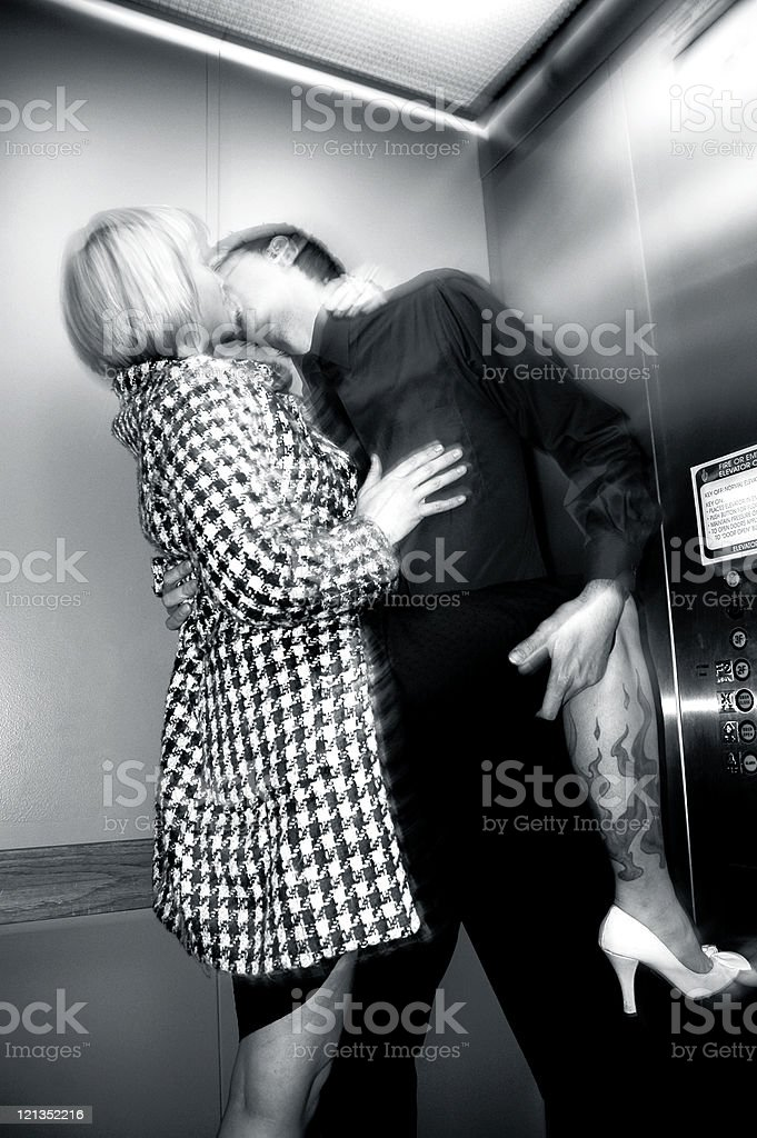 Couple kissing passionately in an elevator royalty-free stock photo