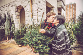 Couple Kissing while Choosing Christmas Tree, City Market, Europe