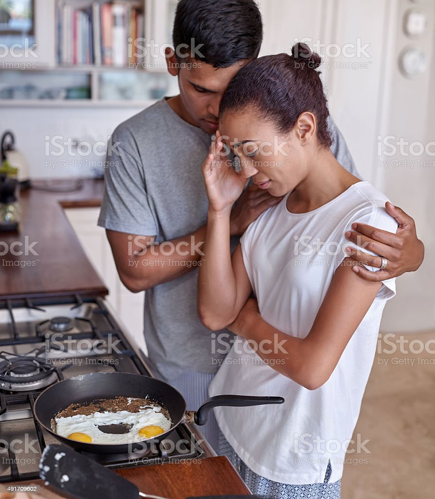 couple kitchen affection stock photo