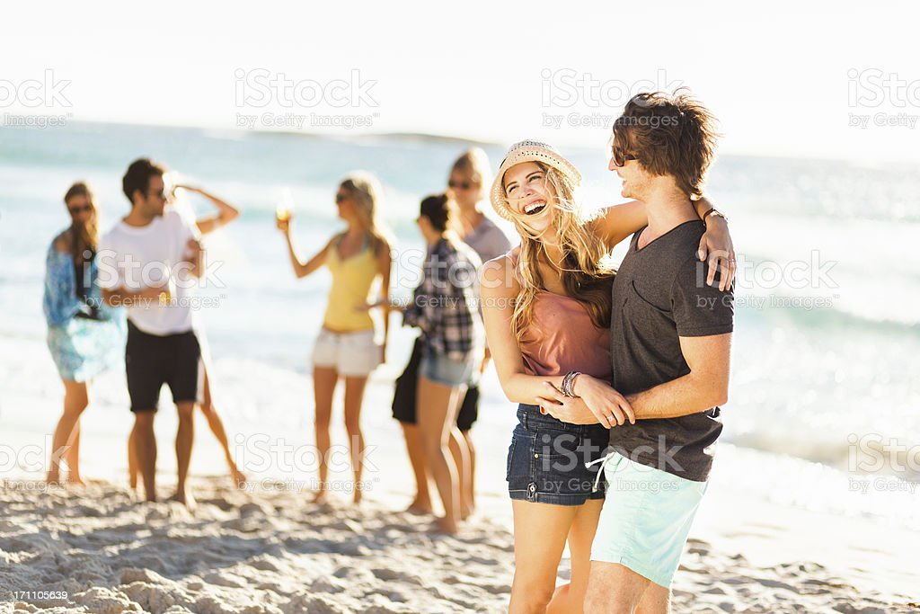 Couple Laughing At A Beach Party royalty-free stock photo