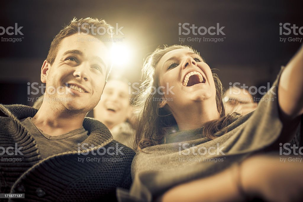 Couple laughing at the cinema, watching comic movie stock photo