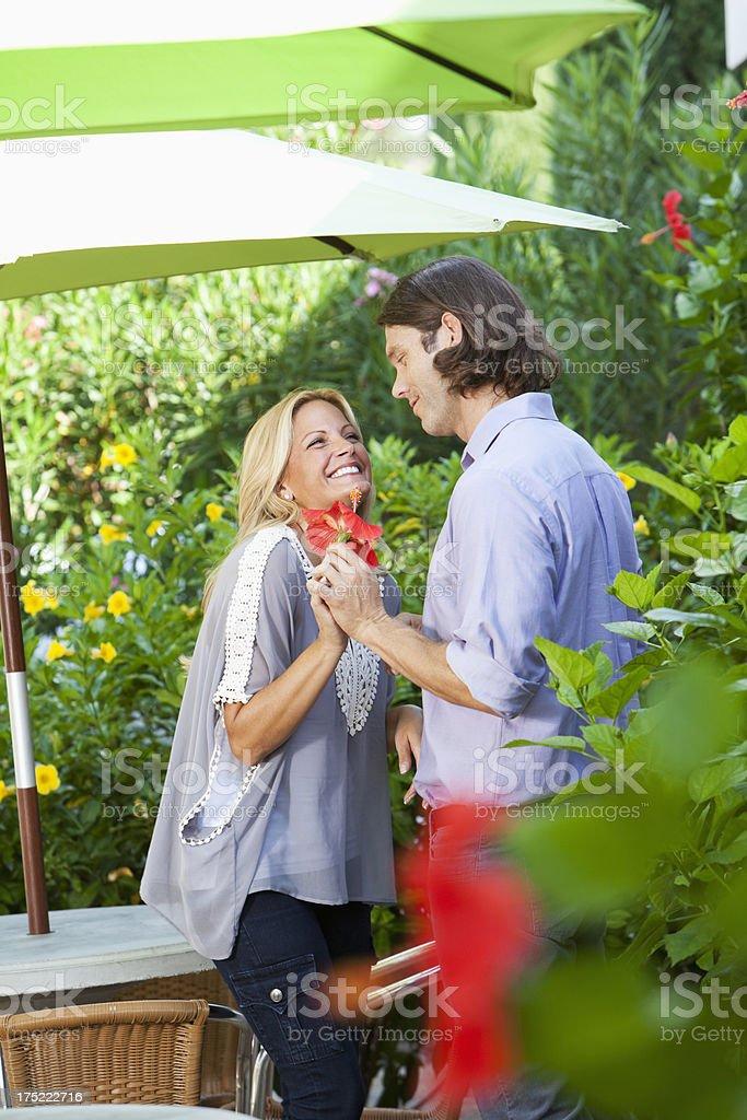Couple laughing on garden patio stock photo