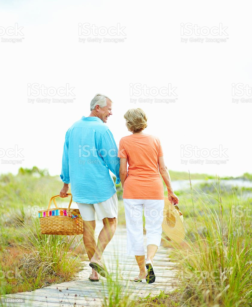 Couple laughing while going for a picnic royalty-free stock photo