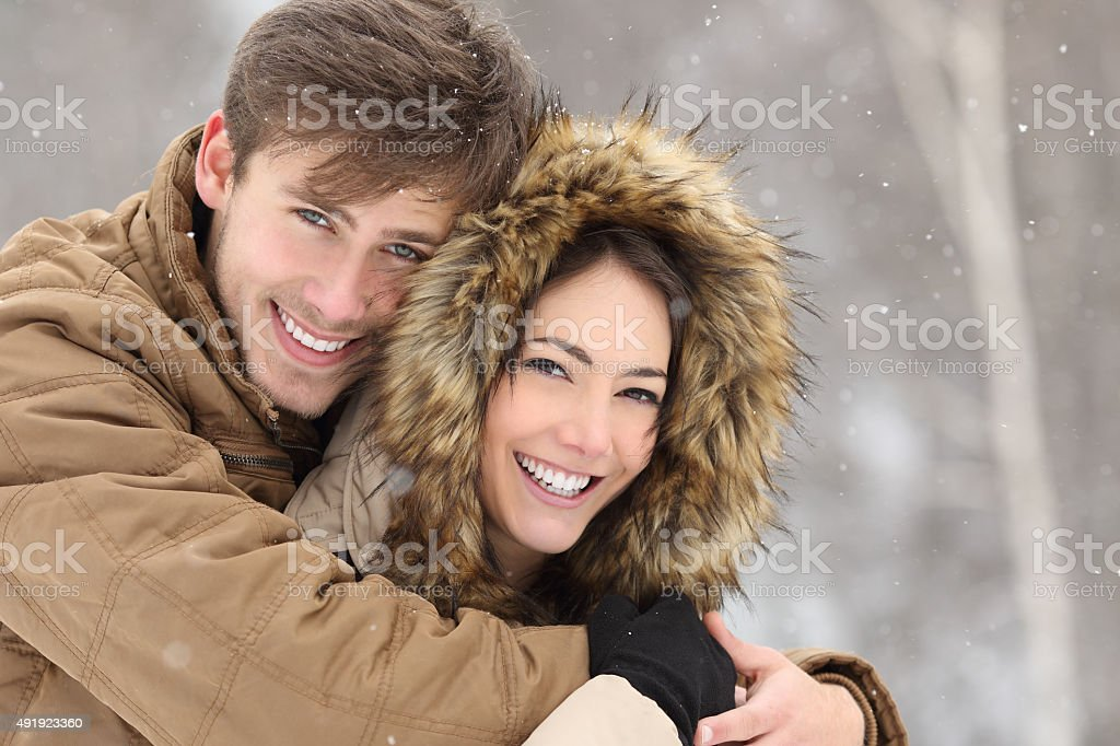 Couple laughing with a perfect smile and white teeth stock photo