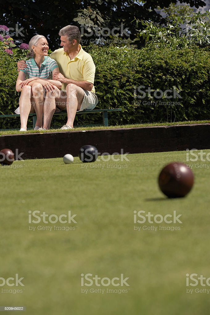 Couple lawn bowling stock photo