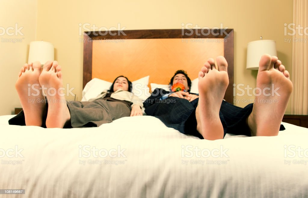 Couple Laying on Bed royalty-free stock photo