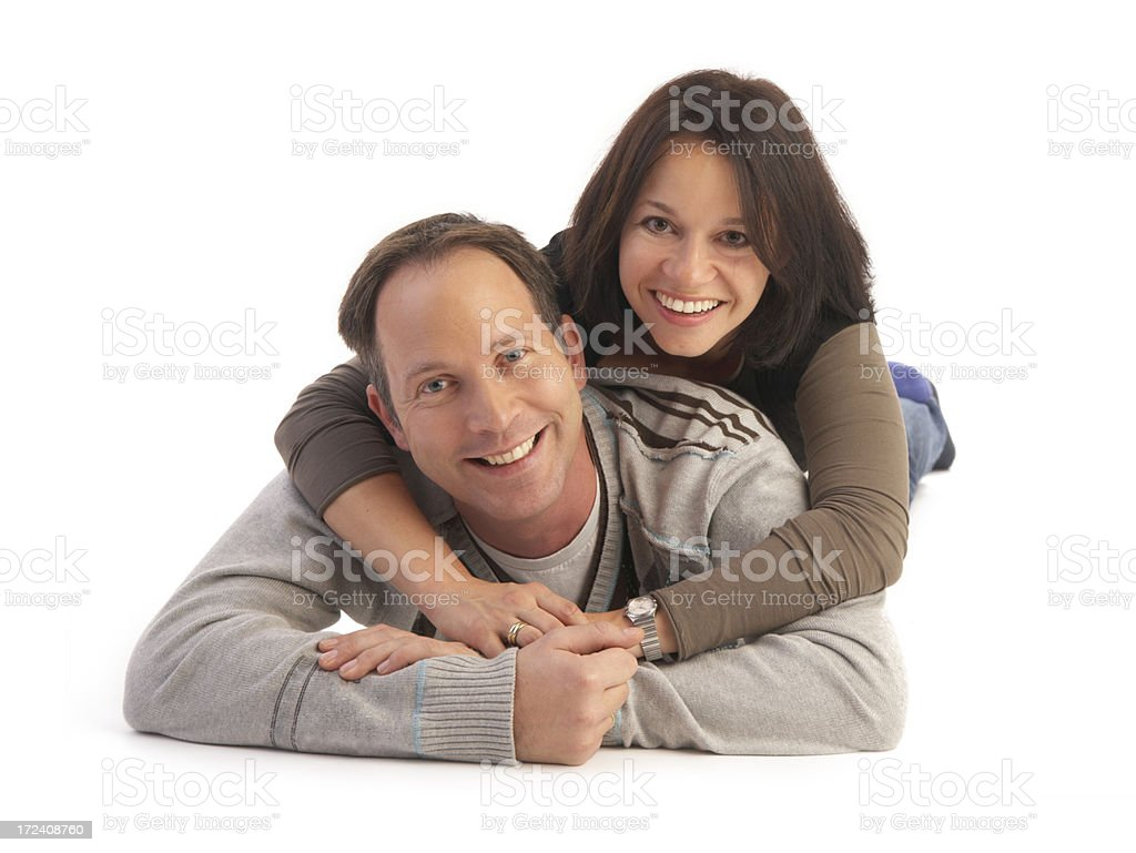 couple laying on the floor laughing royalty-free stock photo