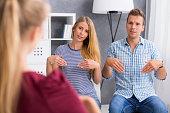 Couple learning sign language