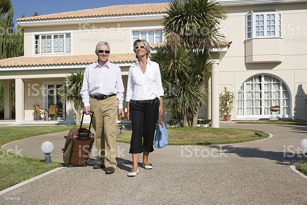 Couple leaving holiday home royalty-free stock photo