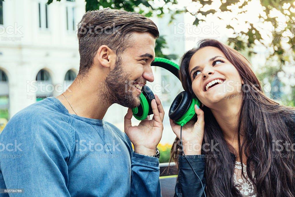 Couple listening to music stock photo