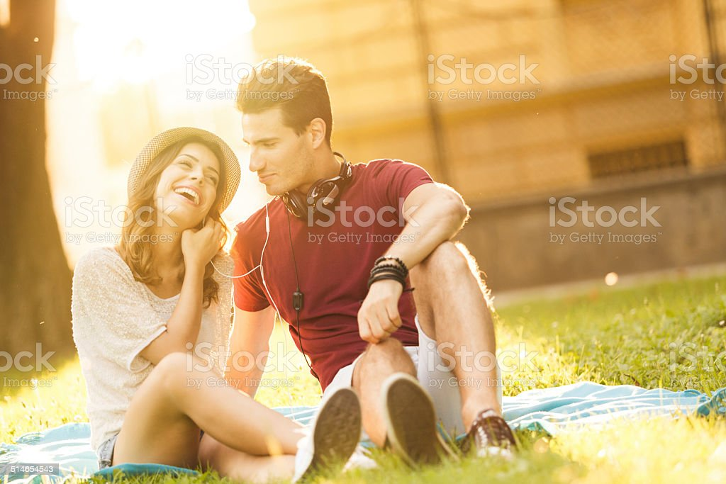 Couple listening to music together stock photo