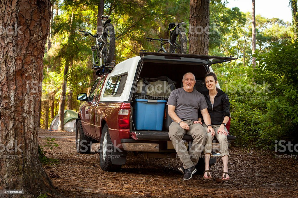 Couple loaded up for camping stock photo
