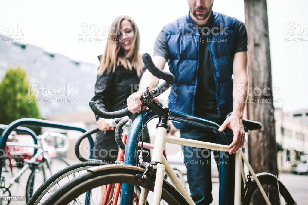 Couple Locking Their Bikes stock photo