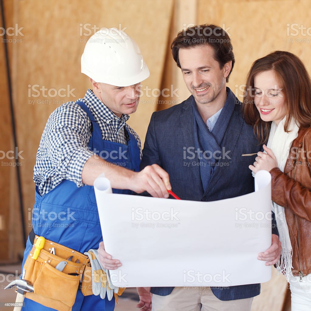 Couple Look At Home Plans stock photo