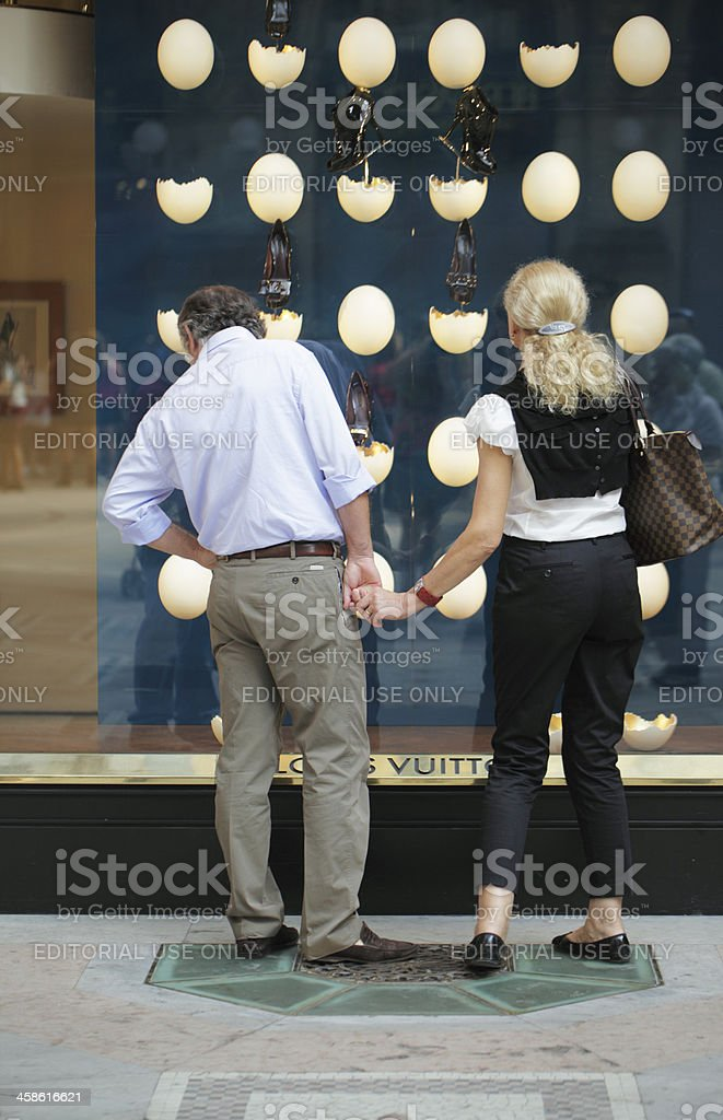 Couple Look at the Louis Vuitton Window Display stock photo