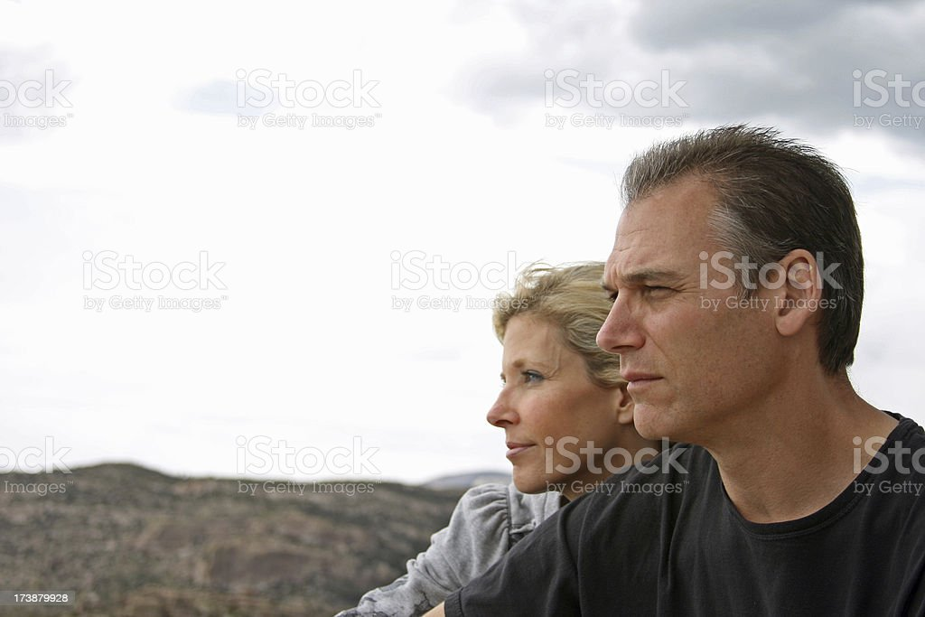 Couple look out across the landscape stock photo