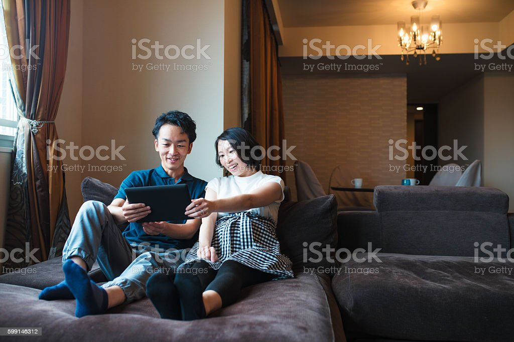 Couple looking at a digital tablet together stock photo