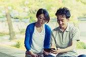 Couple looking at a smartphone together