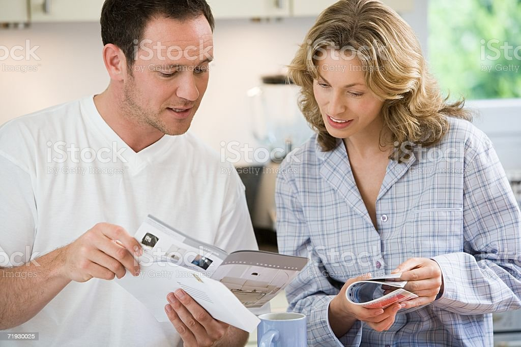 Couple looking at brochures stock photo