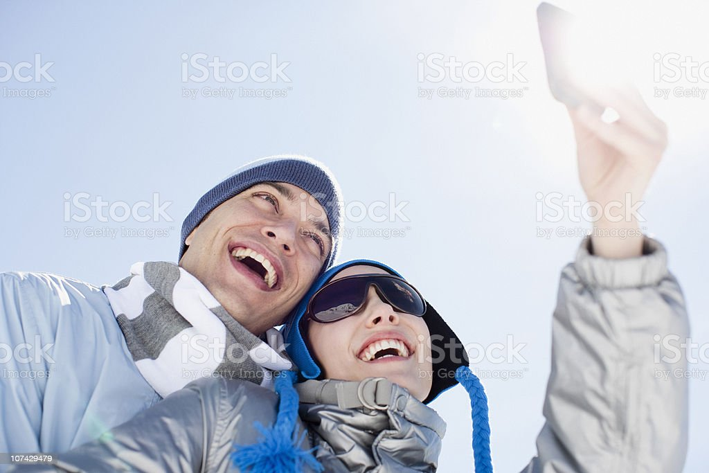 Couple looking at cell phone royalty-free stock photo