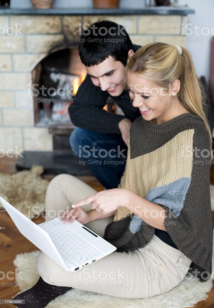 Couple looking at computer on vacation royalty-free stock photo