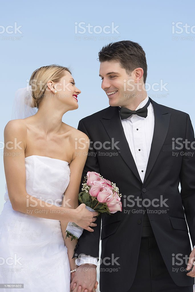 Couple Looking At Each Other Against Clear Blue Sky royalty-free stock photo