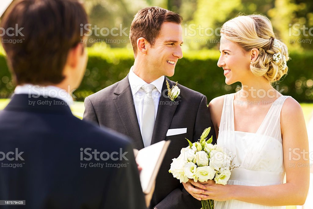 Couple Looking At Each Other During Garden Wedding stock photo