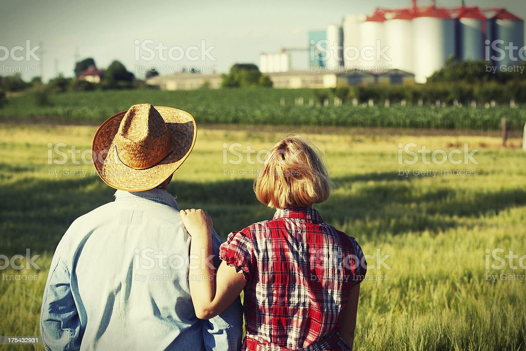 Couple looking at farm stock photo