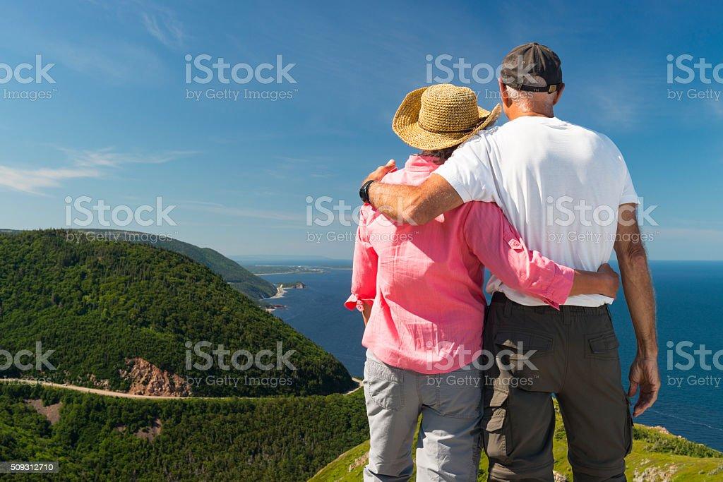 Couple looking at landscape, Skyline, Cabot trail, Cape Breton stock photo