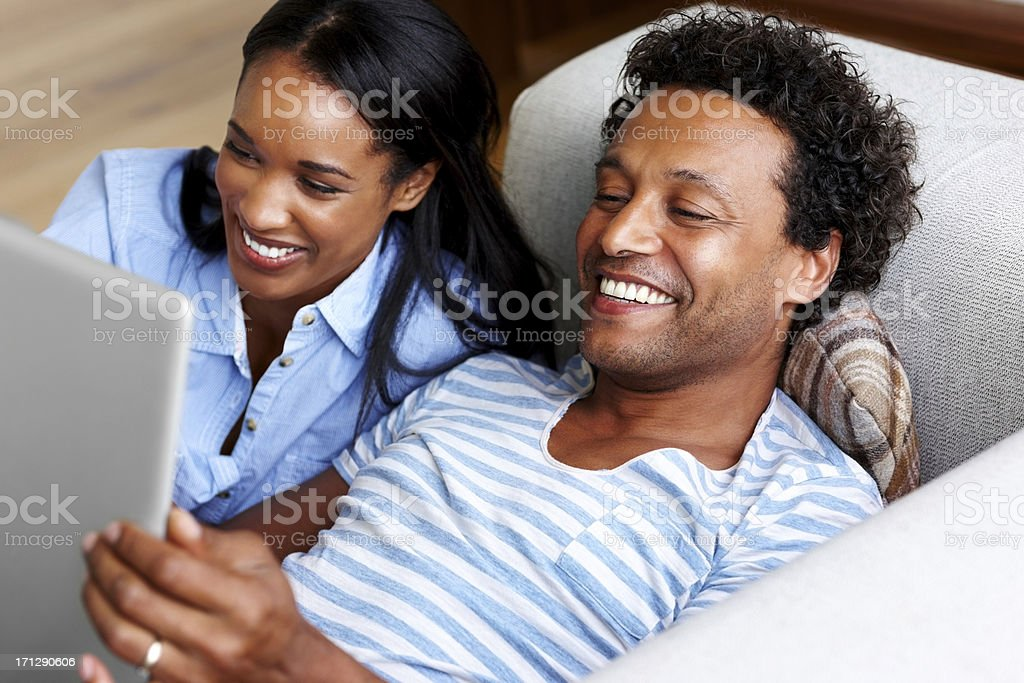 Couple looking at laptop and smiling royalty-free stock photo