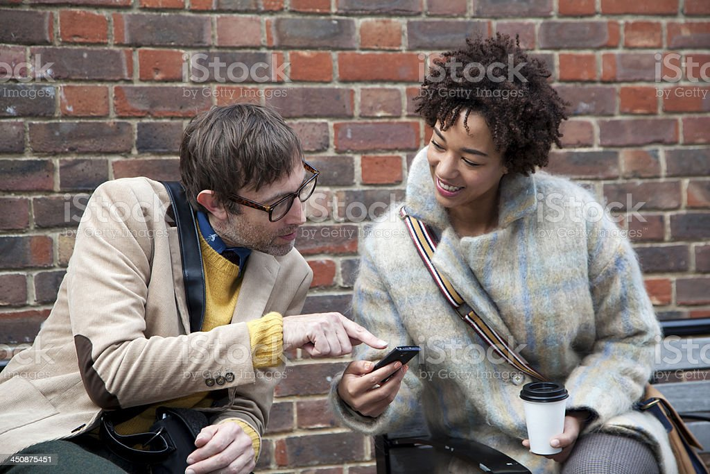couple looking at mobile phone royalty-free stock photo